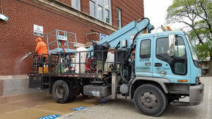 Each day, nearly two dozen graffiti removal trucks operated by Chicago's Department of Streets and Sanitation respond to requests to remove unsightly graffiti.