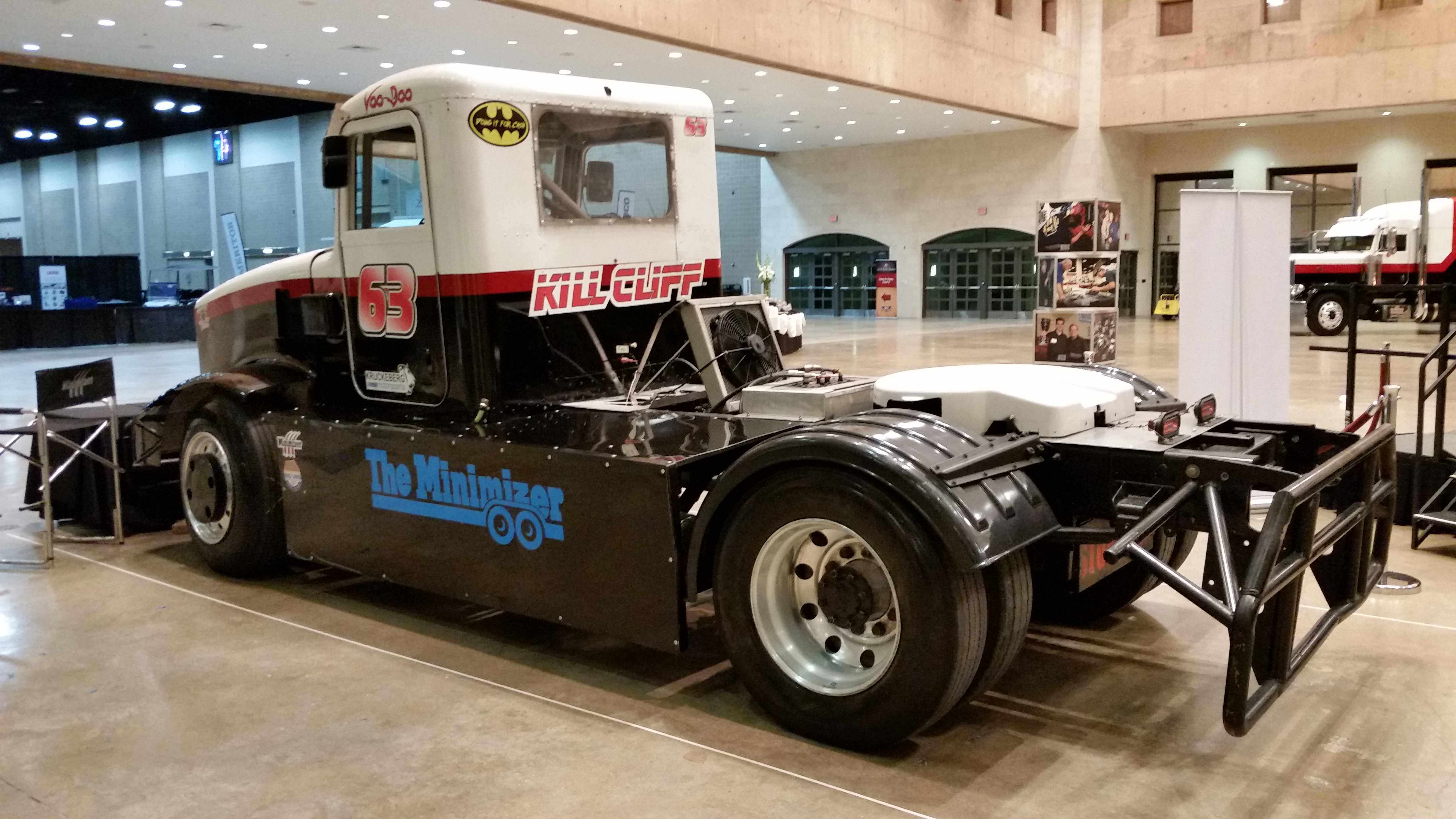 The Minimizer racing semi truck displayed on showroom floor