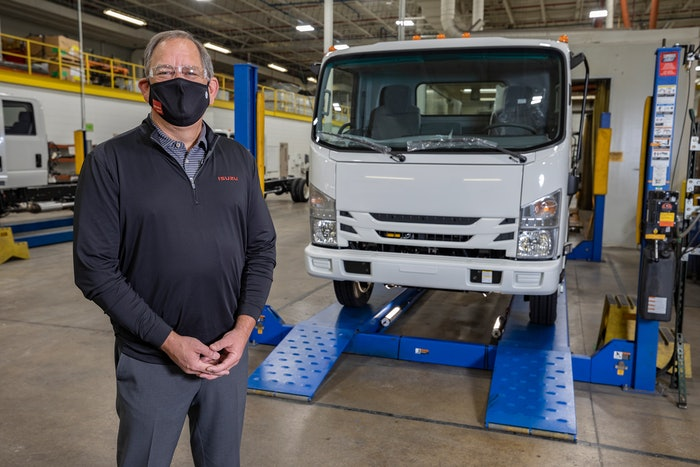 sean skinner, Isuzu Commercial Truck of Canada president, in front of Isuzu truck