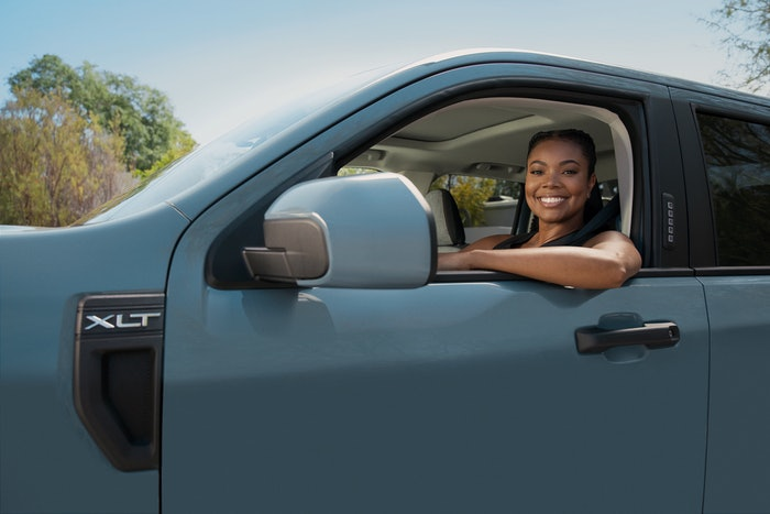 Actress Gabrielle Union sits in the Ford Maverick compact truck. From this picture, we can see that it's a crew cab XLT model with a sun roof and keypad entry. Fleet appeal? Tune into the reveal on Tuesday, June 8 to learn more. If you can't make it, no worries. We'll report on Ford's latest pickup here in Hard Working Trucks. It's a pretty big deal. Ford's last compact, Courier, was yanked in the early 80s in the U.S. to make way for Ranger.