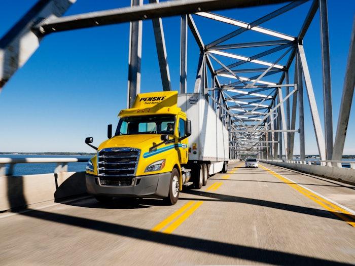 penske truck driving on bridge