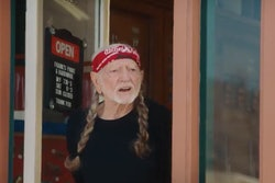 In a brief, humorous ad posted recently by FedEx, Willie Nelson becomes captivated by an electric FedEx step van, the GM BrightDrop EV600.