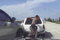 Twenty-three year-old Florida State Trooper Dominic Alexandre is shown in this screenshot dashing out of the way of a pickup that nearly struck him last week in Palm Beach County on Interstate 95.