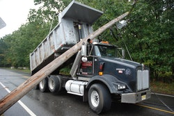 Police say this dump truck was traveling with a raised bed when it brought down power lines this week in Manchester Township, N.J.